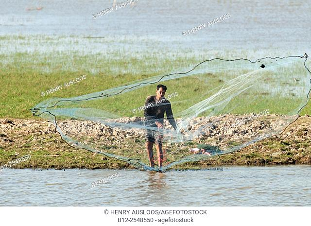 Fisherman with cast net, Tale Noi, Patthalung, Thailand