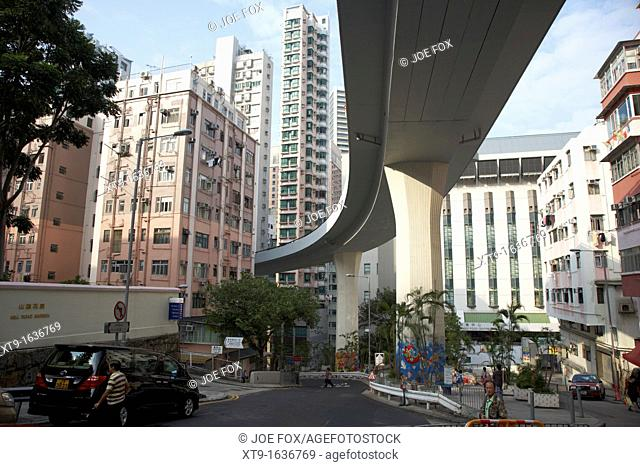 looking up from underneath overhead road snaking between highrise buildings hong kong hksar china asia