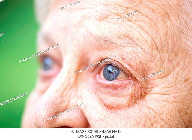Close up of older woman's blue eye
