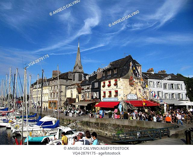 harbour scene with yaughts and harbour restaurants Honfleur, Normandy, France.