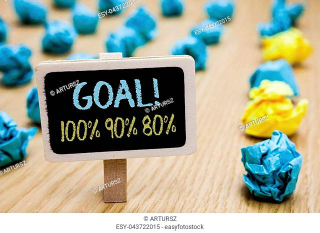 Conceptual hand writing showing Goal 100 90 80. Business photo text Percentage of your objectives fulfilment success level poster board with blurry paper lobs...