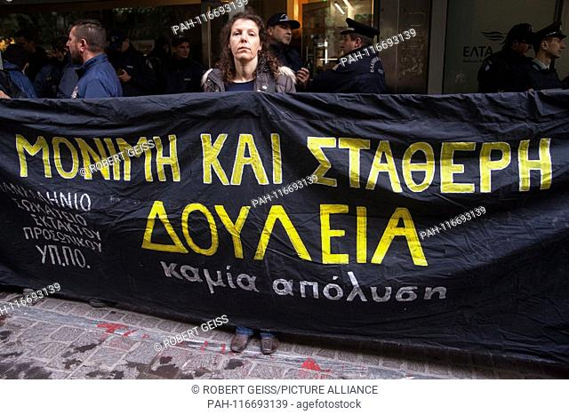 """Greeks Employees of Ministry of Culture, during a rally in front of Ministry of Economy, against layoffs. Writing """"""""Permanent work"""""""". 06.02"""