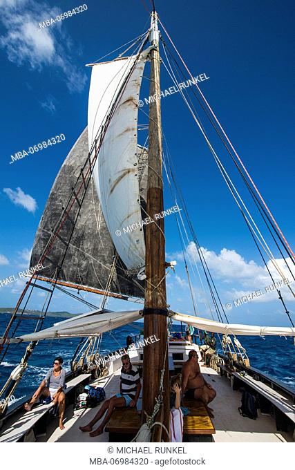 Huge sail of a historic sailing boat, Tobago Cays, St. Vincent and the Grenadines, Caribbean