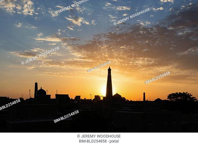 Silhouette of towers at sunset