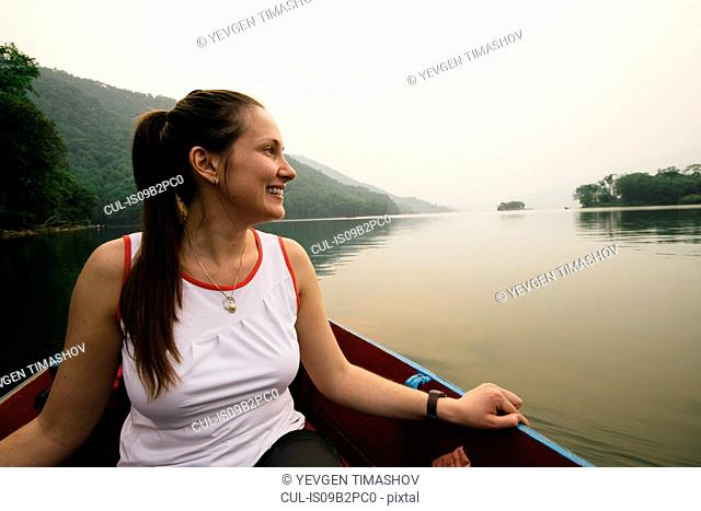 Woman on boat on lake, Pokhara, Nepal