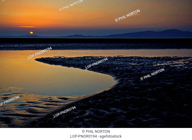 England, Cumbria, Silloth, Sunset over the Bay of Solway with Mount Criffel on the horizon