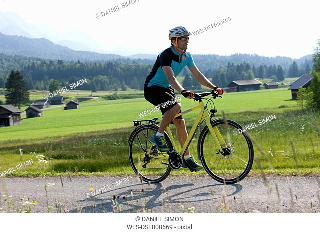 Man on a bicycle tour with trekking bike