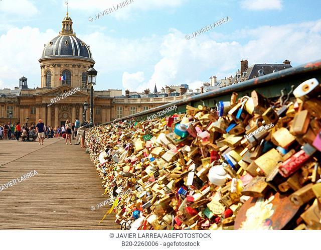 Love padlocks. Pont des Arts bridge. Institut de France. Seine river. Paris. France