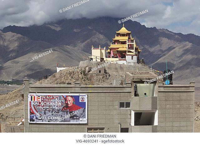 INDIA, CHOGLAMSAR, 03.07.2014, Image of His Holiness the 14th Dalai Lama on a banner advertising the 33rd Kalachakra Pooja in the small Himalayan village of...