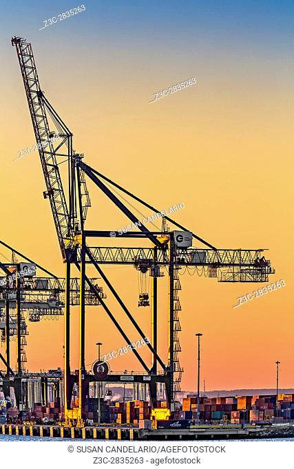 Global Containers Terminal Cargo Freight Cranes - Container cargo freight cranes with the warm colors of the setting sun in the western sky