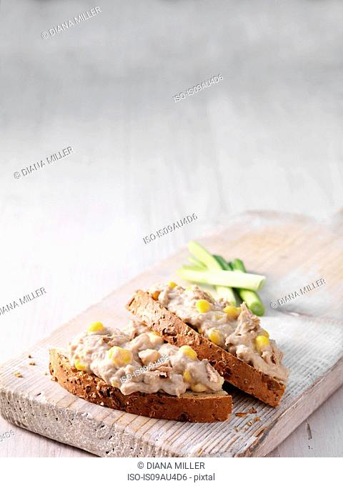 Tuna and mayonnaise on sliced wholemeal bread with spring onion