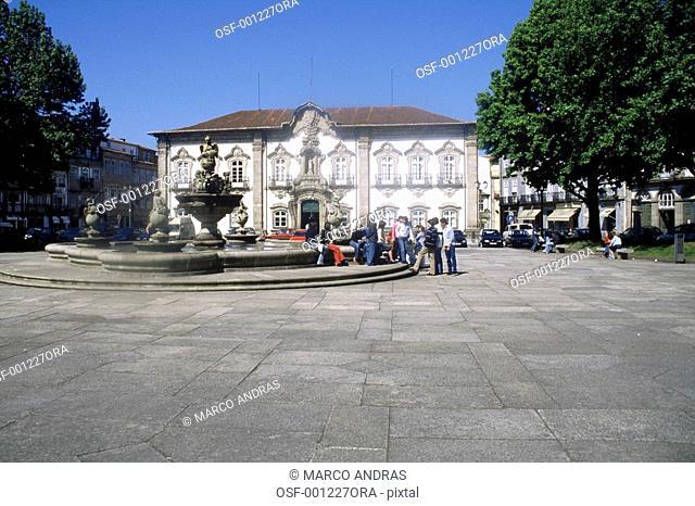portugal people sat down near a fountain