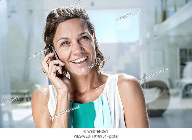 Spain, Mid adult woman talking on cell phone