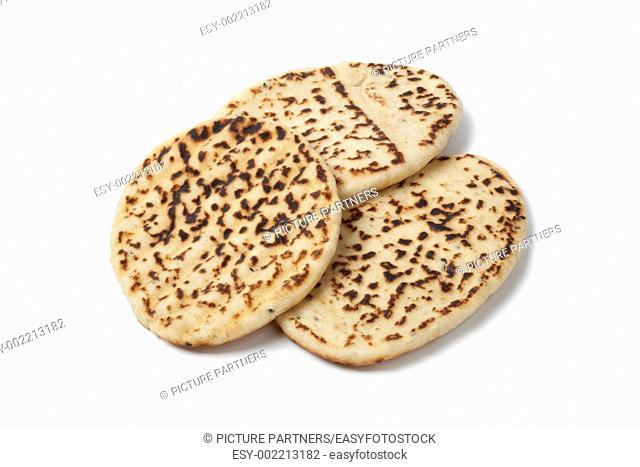 Fresh baked naan on white background
