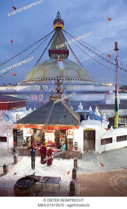 Monks shopping at the stall in temple grounds, Stupa Bodnath, Kathmandu, Nepal