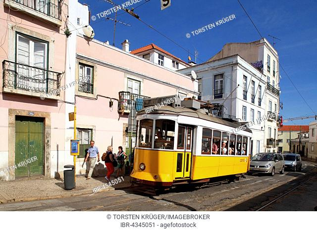 Old yellow tram in the Alfama district, Lisbon, Portugal