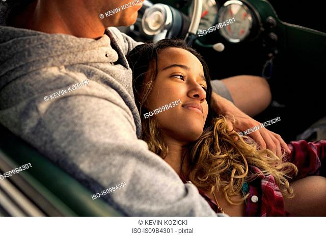 Romantic couple in pickup truck at Newport Beach, California, USA