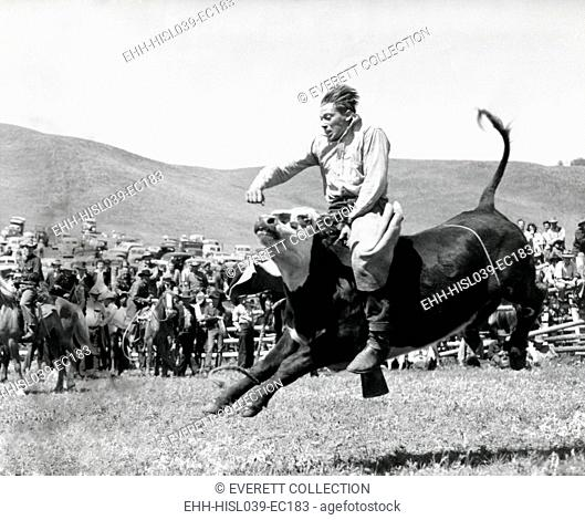 Bull Rider at American Rodeo. Ca. 1950. - (BSLOC-2014-17-112)