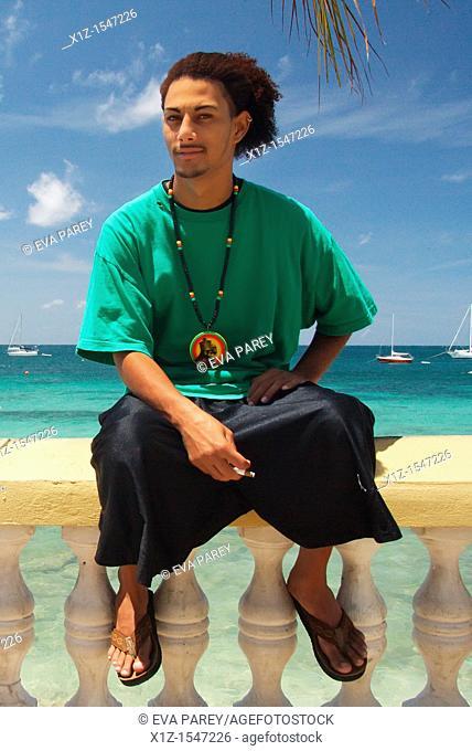 A boy stands at a beach in Esperanza city in Vieques, Puerto Rico
