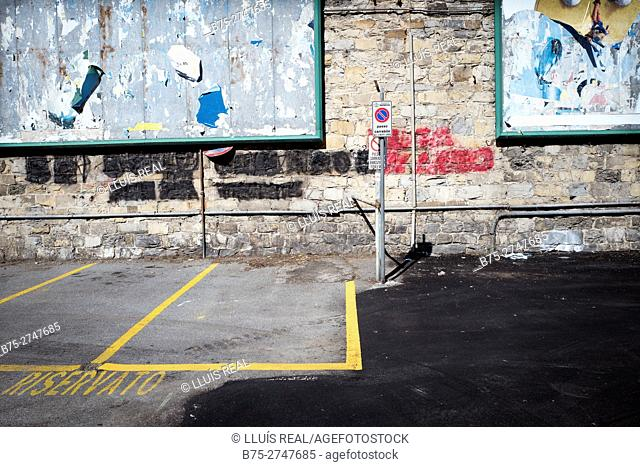 "Parking lot with the sign ""Reservato"" (reserved). Genova, Italy"