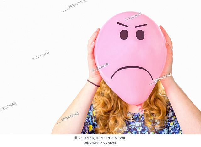 Pink balloon with expression in front of girls fa