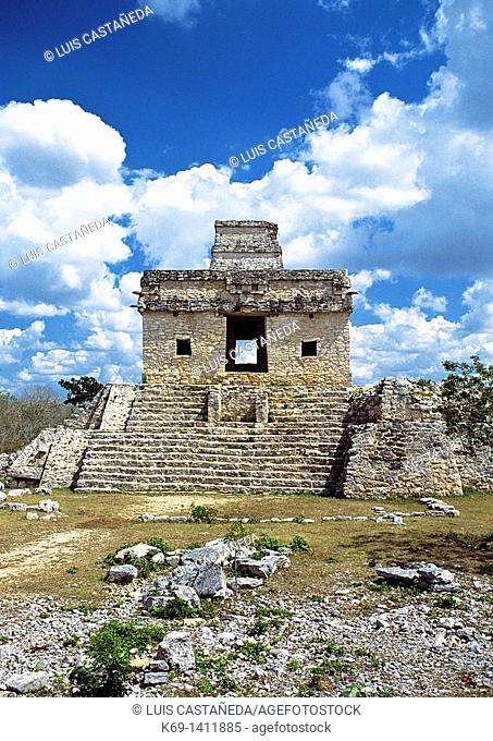Temple of the Dolls Templo de las Siete Muñecas is an imposing looking building on a pyramidal base with a short tower atop its roof  A monolithic stela stands...