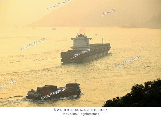 China, Hong Kong, New Territories, Marine Traffic in the Ma Wan Channel by the Tsing Ma Bridge and Lantau Island, sunset