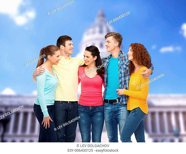 friendship, tourism, washington and people concept - group of smiling teenagers standing over white house background