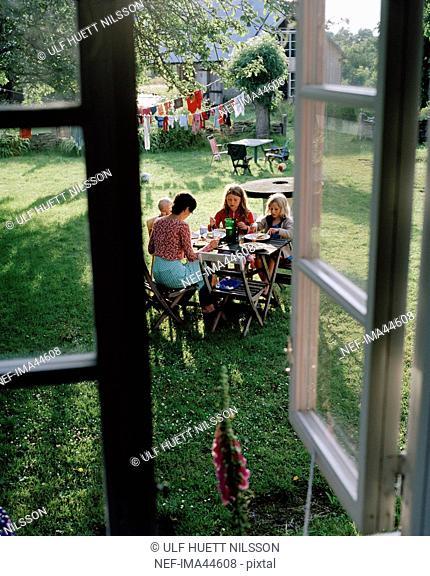 Family having lunch in the garden, Oland, Sweden