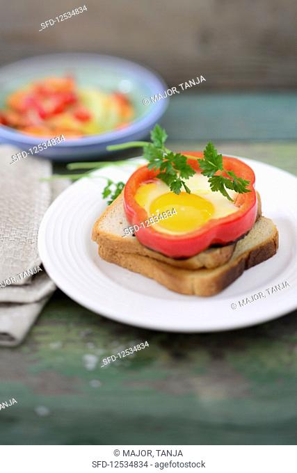 Pepper fried eggs on toast with carrot and cucumber salad