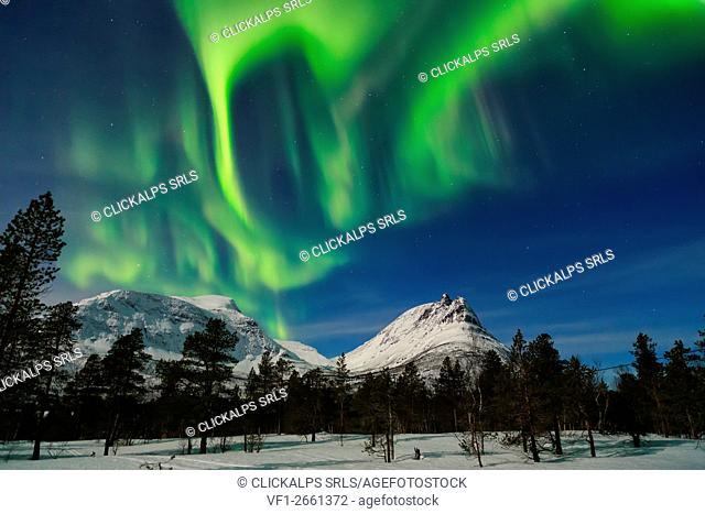 "The Northern Lights Aluminate over the mountain peaks at ""The Corner Kick† Lofoten Islands, Norway"