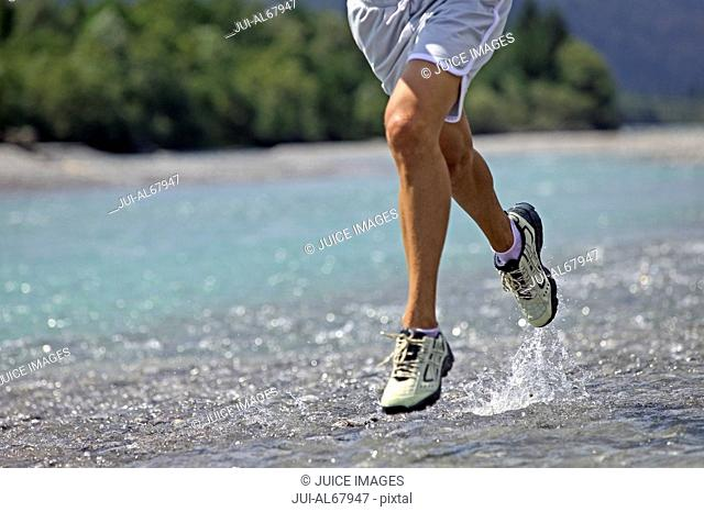 Close up, man running on water