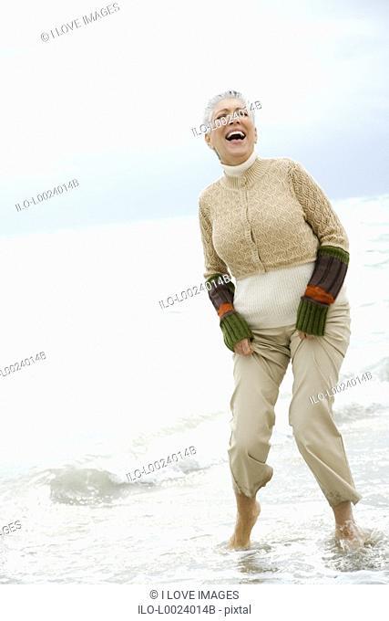 A senior woman on a beach