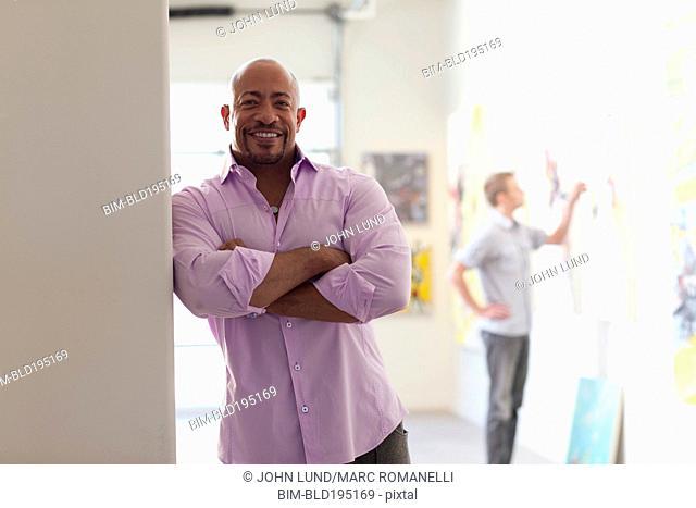 Mixed race man in art gallery