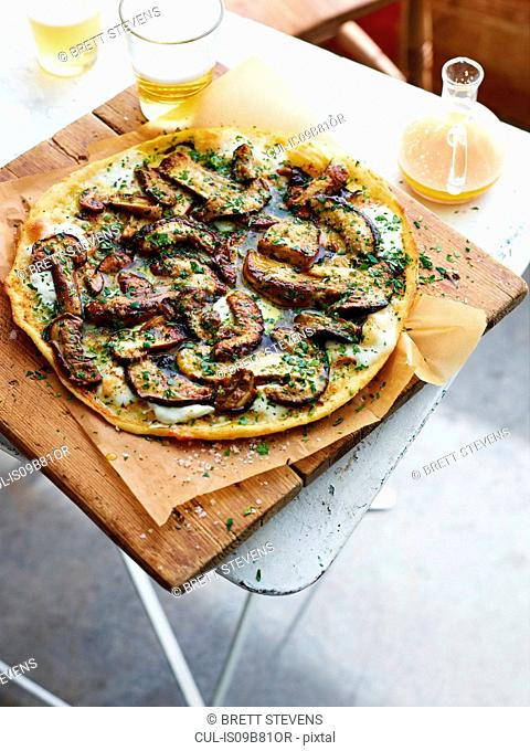 Porcini pizza on serving board, elevated view