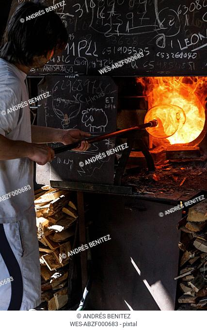 Man using a furnace in a glass factory