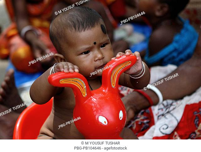 A child rides on the plastic toy on occasion of the Charak Puja Gopalgonj, Bangladesh April 15, 2010
