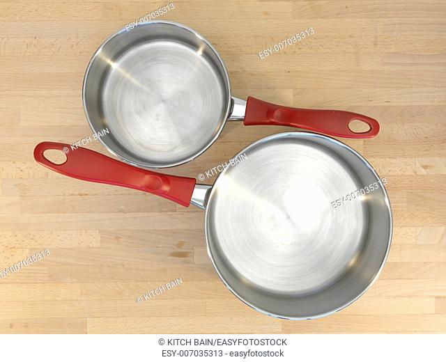 A close up shot of kitchen pots and pans