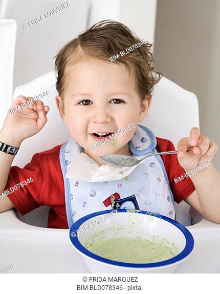 Hispanic boy eating cereal
