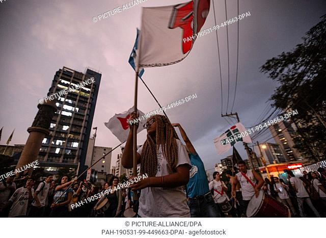 30 May 2019, Brazil, Sao Paulo: Demonstrators protest against the education policy of President Bolsonaro's government. Students and professors protested...