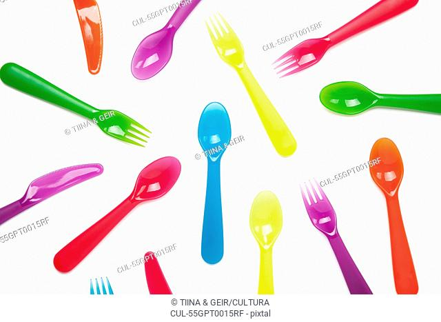 Colourful plastic knives, forks, spoons