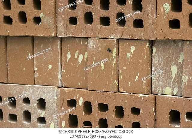 New but dirty semi-engineering bricks construction background