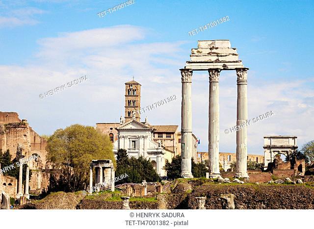 Columns of Roman Forum against blue sky