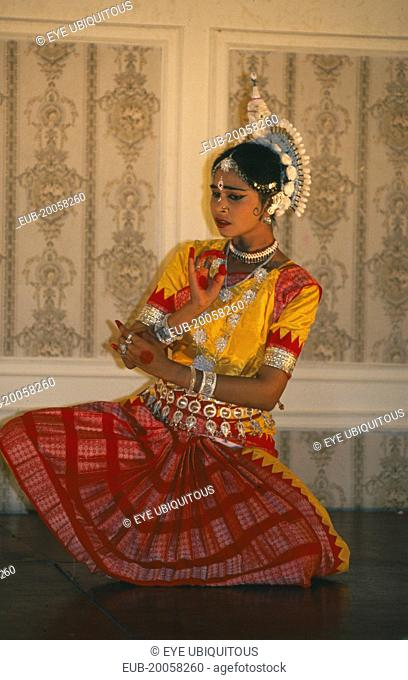 Clasical Indian dancer performing Odissi Temple style dance