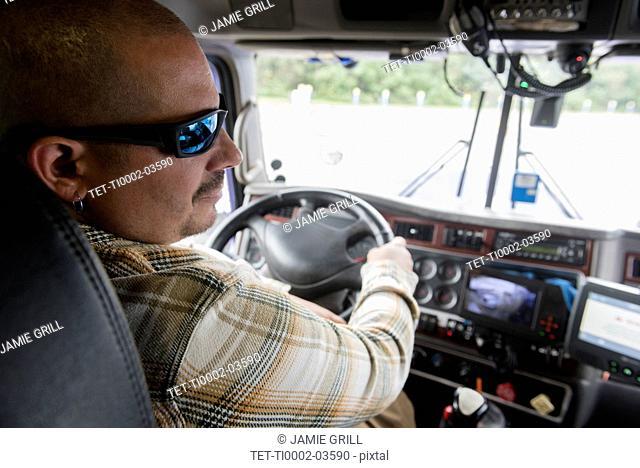 Man driving semi-truck