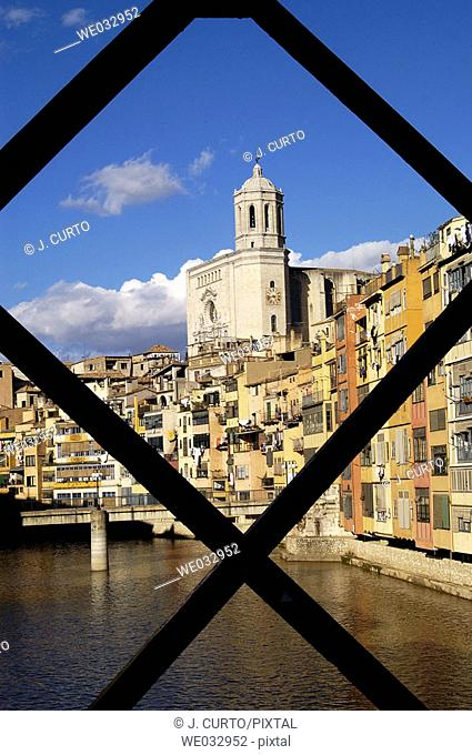 Cathedral and houses by Onyar river from Eiffel bridge, Girona. Catalonia, Spain