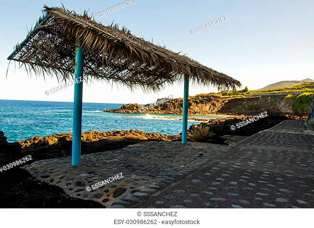 Umbrella on the island of Gran Canaria palm in a place called blue lake