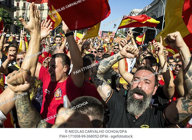 Thousands of people protest with Catalonian and Spanish flags against the independence movement and the regional government's speraratist plans in Barcelona