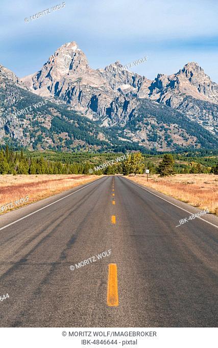 Country road in front of Grand Teton Range, Grand Teton National Park, Wyoming, USA