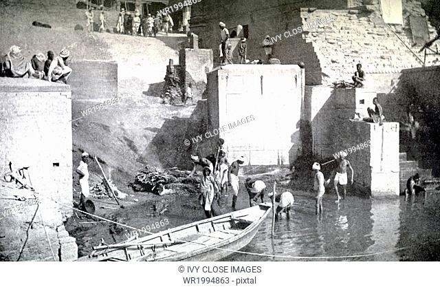 This photograph dating to around 1913 shows Hindus preparing to cremate someone who has died at a cremation ghat at Benares, India
